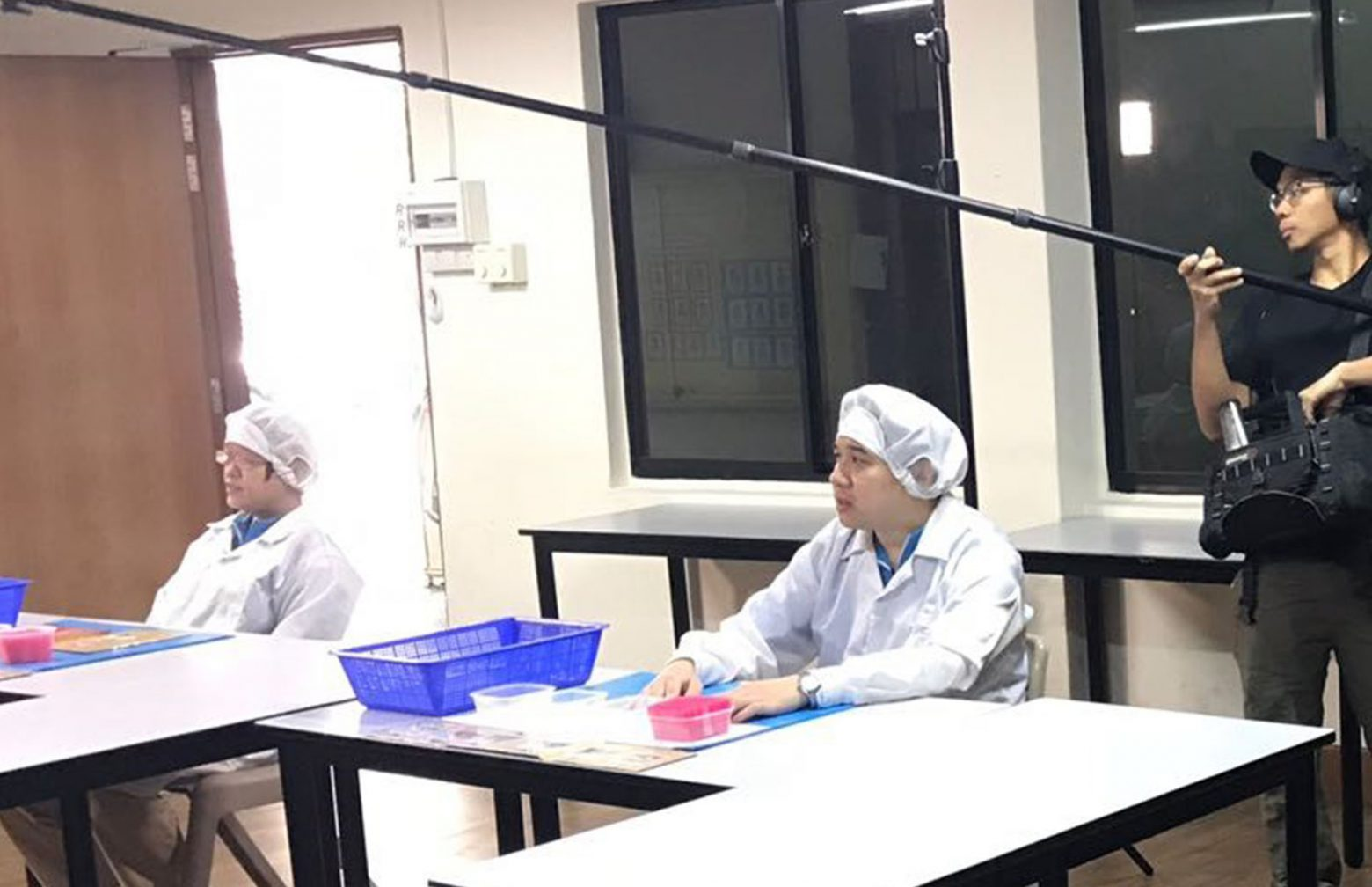 two Sivantos employees at Singapore with protective clothing getting interviewed