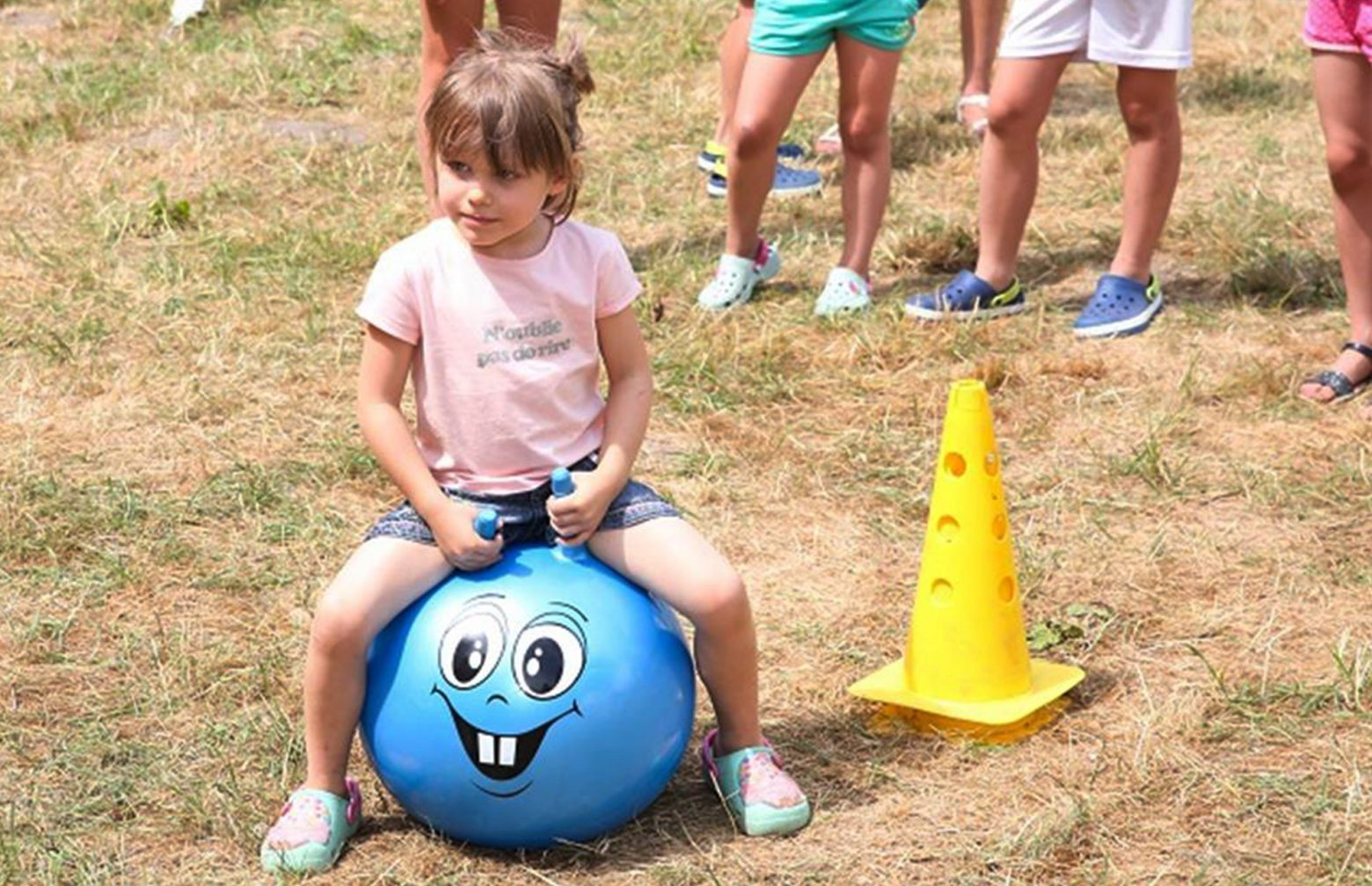 girl on a blue space hopper during the family day in Poland