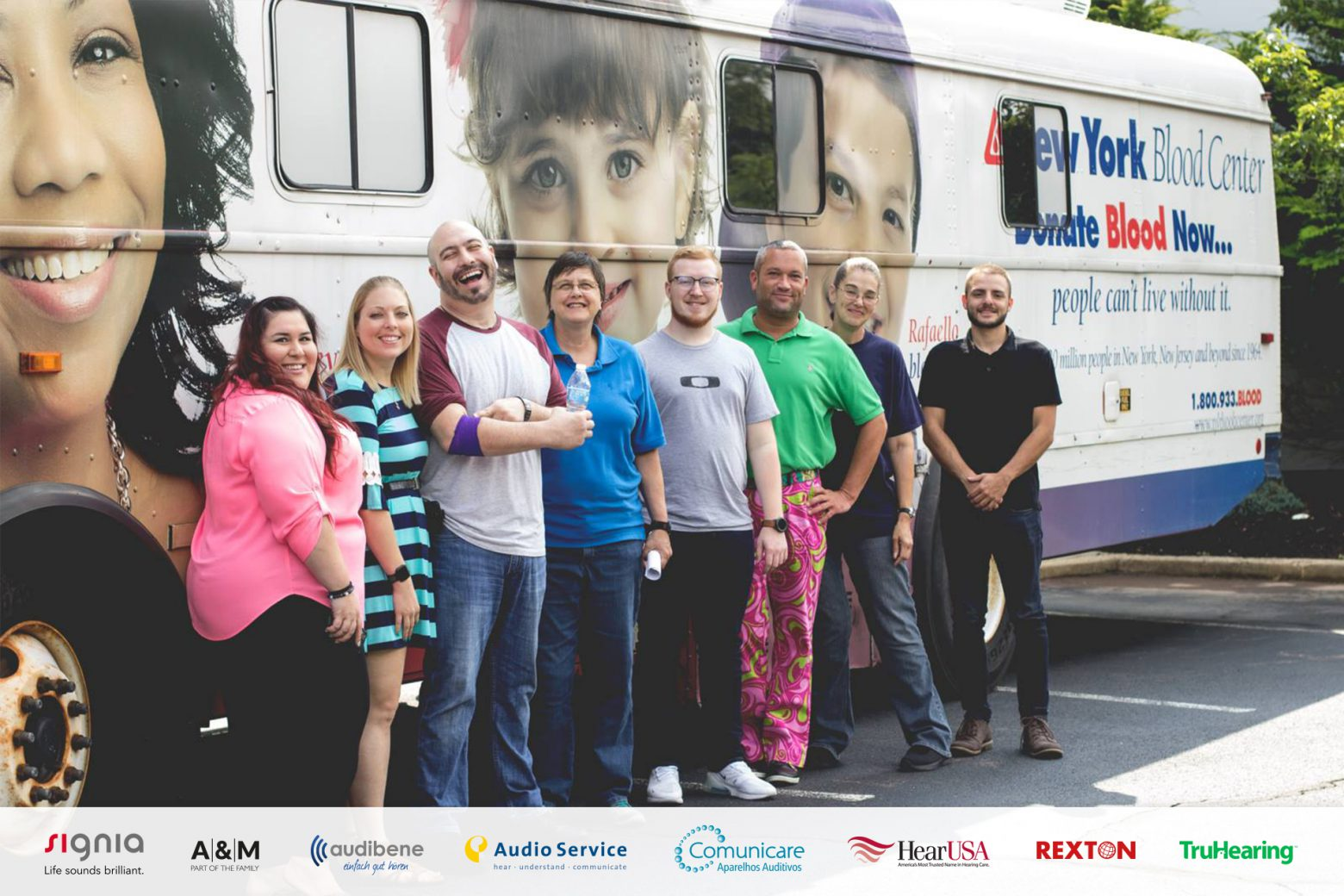 Sivantos employees in front of the truck from the New York Blood Center
