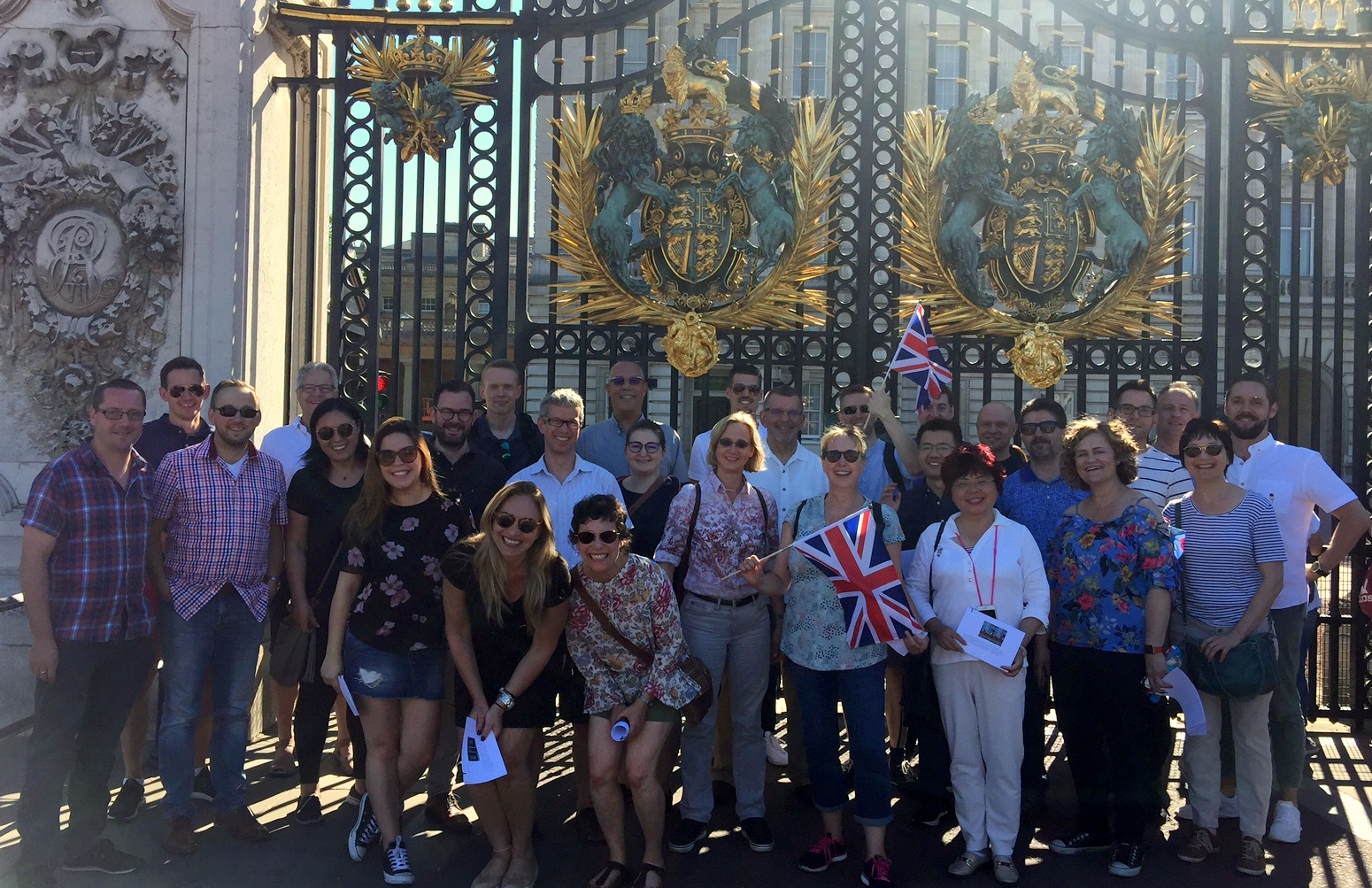 participants in front of the Buckingham palace gate in London